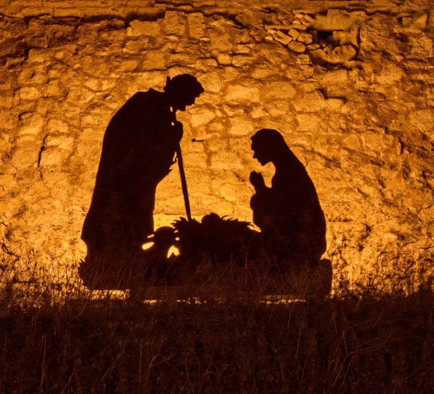 nominated-the-silhouettes-of-mary-and-joseph-of-earthly-parents-bowed-over-the-newborn-jesus-christ_t20_gopBXx